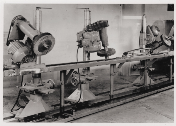 black and white photo of early abrasive flap wheels being developed.
