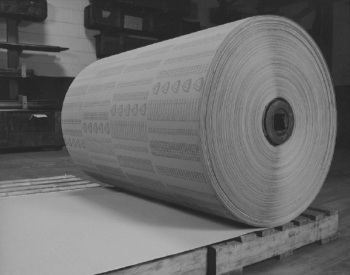 black and white photo of large roll of coated sandpaper