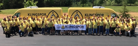 A wide group of people wearing yellow shirts. 